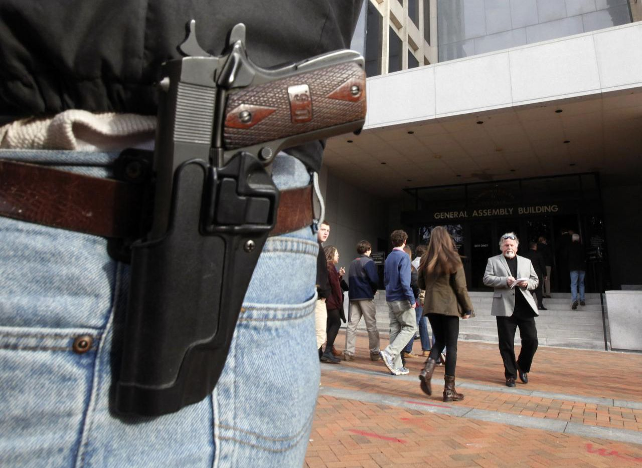 A pistol is worn by gun-rights advocate John Savarese, from Chesterfield County, Va., as he stands outside the General Assembly Building in Richmond, Va..