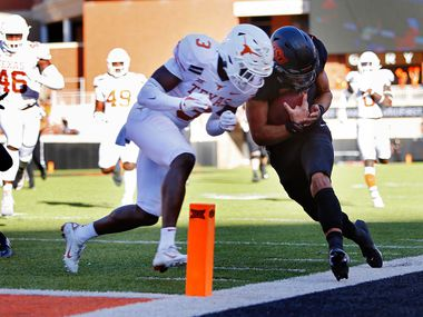 STILLWATER, OK - OCTOBER 31:  Quarterback Spencer Sanders #3 of the Oklahoma State Cowboys gets hit out of bounds by defensive back Jalen Green #3 of the Texas Longhorns on a 35-yard run to set up a touchdown by Chuba Hubbard in the second quarter Boone Pickens Stadium on October 31, 2020 in Stillwater, Oklahoma.   (Pool Photo by Brian Bahr/Getty Images) EDITORIAL USE ONLY  *** Local Caption *** Spencer Sanders;Jalen Green