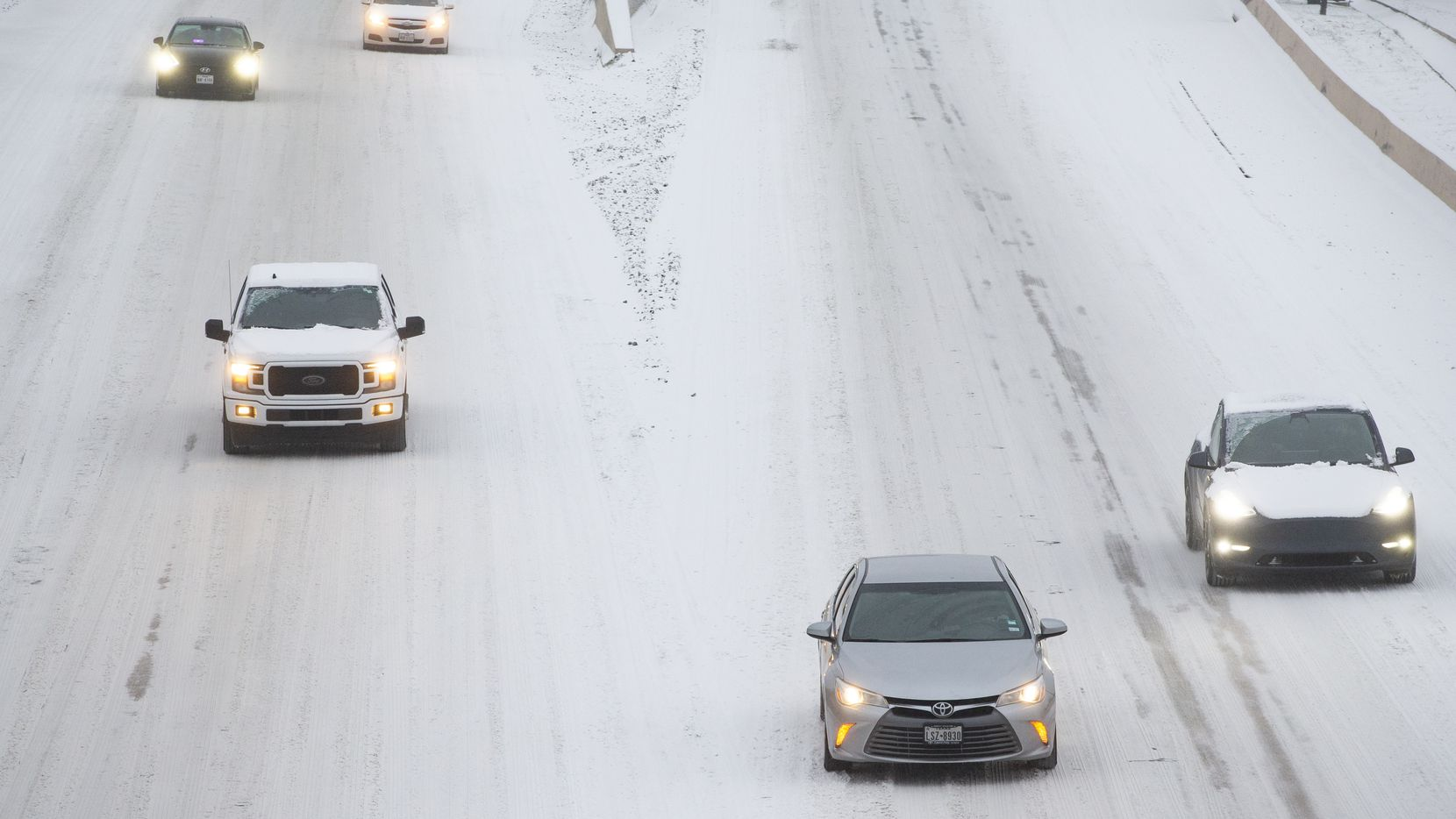 Traffic seen on a snowy and icy North Central Expressway in Dallas on Wednesday, Feb. 17, 2021. Millions of Texans have lost power amid this record-breaking winter storm. (Juan Figueroa/ The Dallas Morning News)