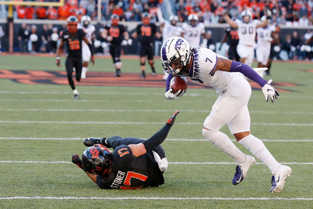 TCU safety Trevon Moehrig (7) comes down with the ball on an interception on a pass intended for Oklahoma State wide receiver Dillon Stoner (17) in the second half of an NCAA college football game in Stillwater, Okla., Saturday, Nov. 2, 2019.