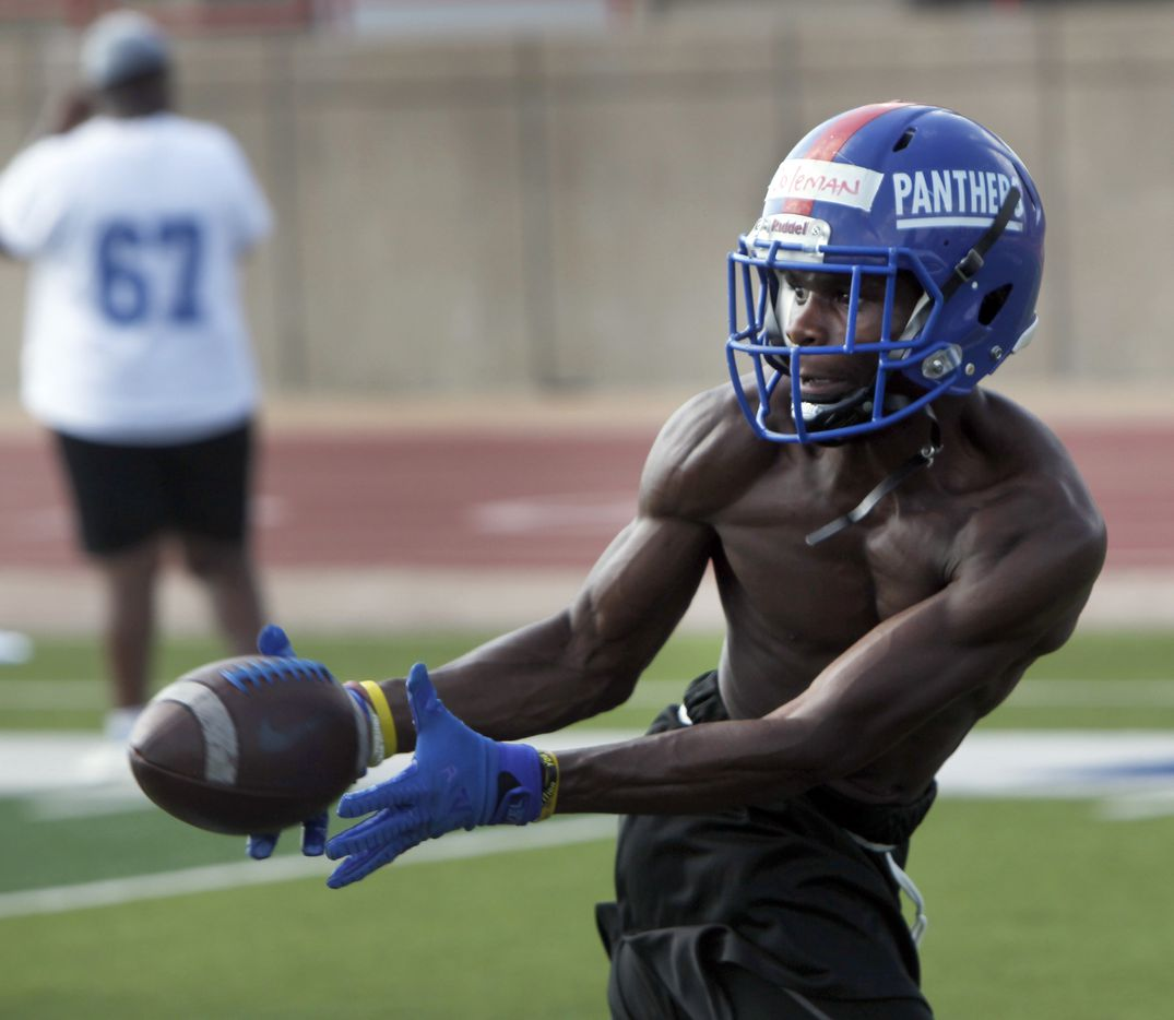 Duncanville Panthers' Damyrion Coleman shows fine focus as he pulls in a pass out of the backfield during a drill. The Duncanville varsity football team conducted their 2021season football opening practice at Panther Stadium in Duncanville on August 9, 2021. (Steve Hamm/ Special Contributor)