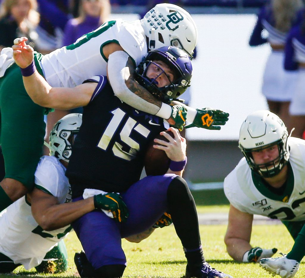 TCU Horned Frogs quarterback Max Duggan (15) is brought down by a swarm of Baylor Bears defenders during the first half of an NCAA football matchup between the Texas Christian University Horned Frogs and the Baylor Bears at Amon G. Carter Stadium in Fort Worth, Texas, on Saturday, No. 9, 2019. (Ryan Michalesko/The Dallas Morning News)
