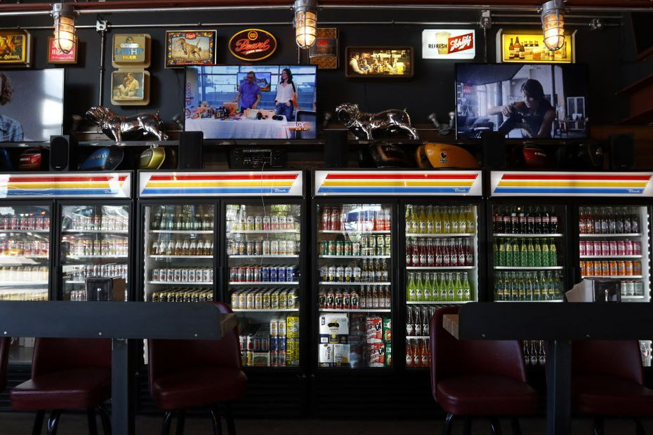 Fridges of soda, beer and fruit drinks line the west wall of Off-Site Kitchen's new location in Trinity Groves in Dallas.