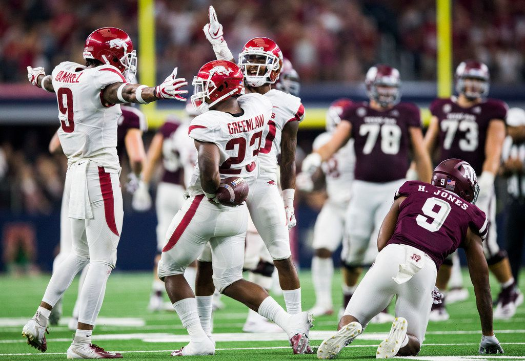FILE - Arkansas Razorbacks linebacker Dre Greenlaw (23) celebrates with team mates after intercepting a pass intended for Texas A&M Aggies wide receiver Hezekiah Jones (9) during the second quarter of an NCAA football game between Texas A&M and Arkansas on Saturday, September 29, 2018 at AT&T Stadium in Arlington, Texas. (Ashley Landis/The Dallas Morning News)