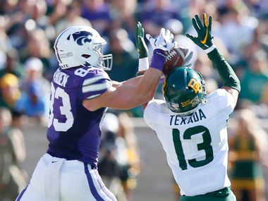 Kansas State wide receiver Dalton Schoen (83) reaches over Baylor cornerback Raleigh Texada (13) for a first-half reception at Snyder Family Stadium in Manhattan, Kan., on Saturday, Oct. 5, 2019.