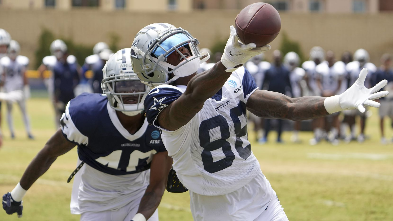 Dallas Cowboys wide receiver CeeDee Lamb (88) makes a catch for a Dallas Cowboys touchdown during a two-minute drill as cornerback Nahshon Wright (40) defends during a practice at training camp on Saturday, July 31, 2021, in Oxnard, Calif.