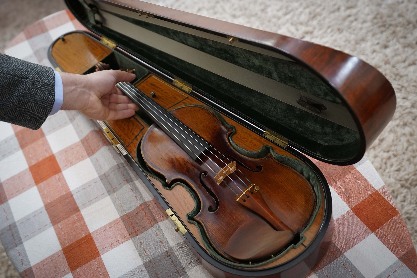 Aaron Boyd's violin sits in its case on Thursday. The instrument was made in Venice in 1690 by Matteo Goffriller, a renowned craftsman of string instruments.