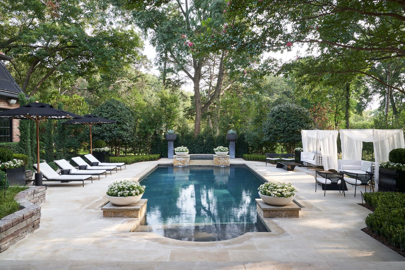 The backyard at the Kips Bay Decorator Show House Dallas. This space was designed by Melissa Gerstle Design.