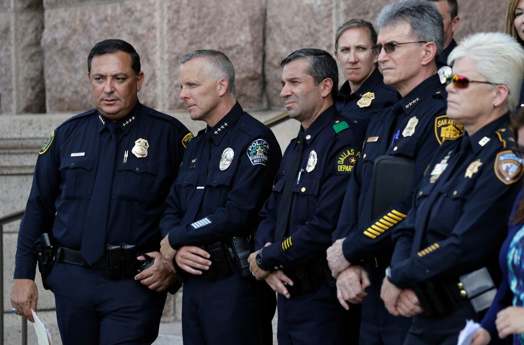 """Houston Police Chief Art Acevedo, from left, Austin Police Chief Brian Manley, Dallas Police Major Rueben Ramirez and San Antonio Police Chief William McManus take part in public safety event where they spoke against a proposed """"bathroom bill,"""" on Tuesday in Austin."""