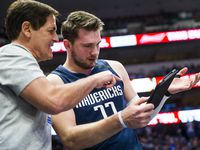 Dallas Mavericks guard Luka Doncic (77) looks at a play with Mavs owner Mark Cuban during the first quarter of an NBA game between the Indiana Pacers and the Dallas Mavericks on Sunday, March 8, 2020 at American Airlines Center in Dallas.