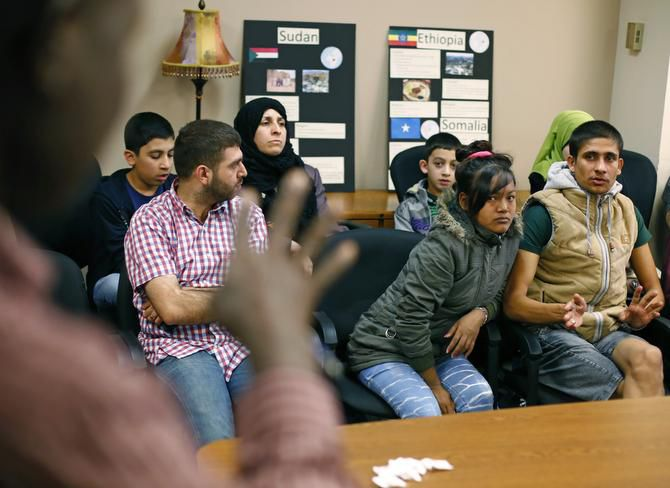 "Gov. Greg Abbott on Friday said that Texas would not accept any more refugees for initial resettlement this year. Abbott said Texas bears a ""disproportionate"" burden from illegal immigration and must concentrate limited resources on the needy already here, such as these refugees at Catholic Charities of Dallas last August."