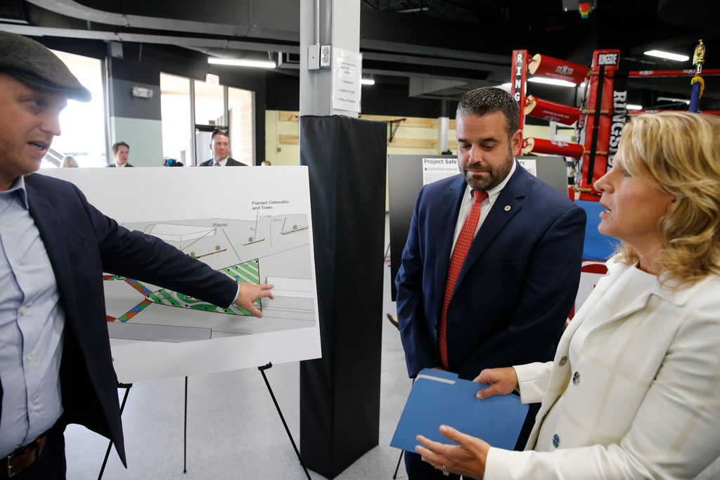 Jason Roberts of the Better Block (left) shows off his Five Points rendering to Dallas City Council members Adam McGough and Jennifer Staubach Gates.
