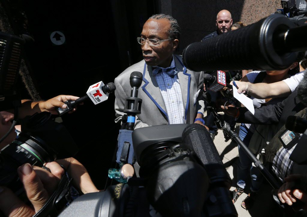 John Wiley Price leaves the federal courthouse in downtown Dallas in July 2014 after his initial court appearance following his arrest on corruption charges. (David Woo/The Dallas Morning News)