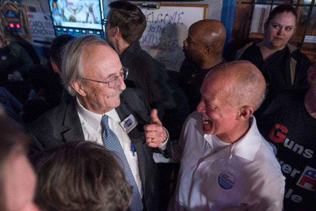 Judge Ken Molberg (left) celebrates with John Creuzot during a watching party at the Dallasite in March.  (Rex C. Curry/Special Contributor)