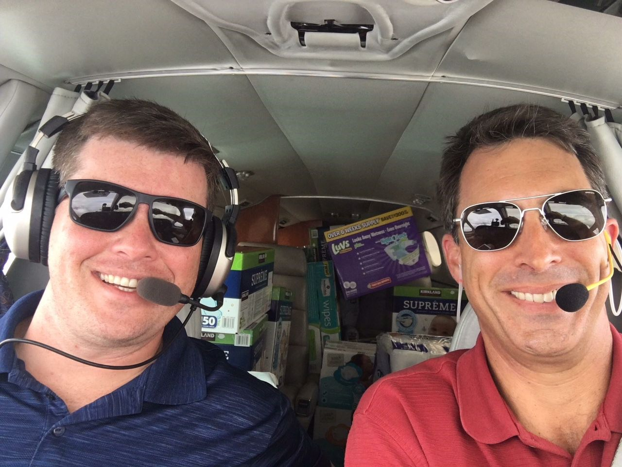 Brian Kelly (left) and Robert Johnson (right) delivering supplies for Operation Airdrop.