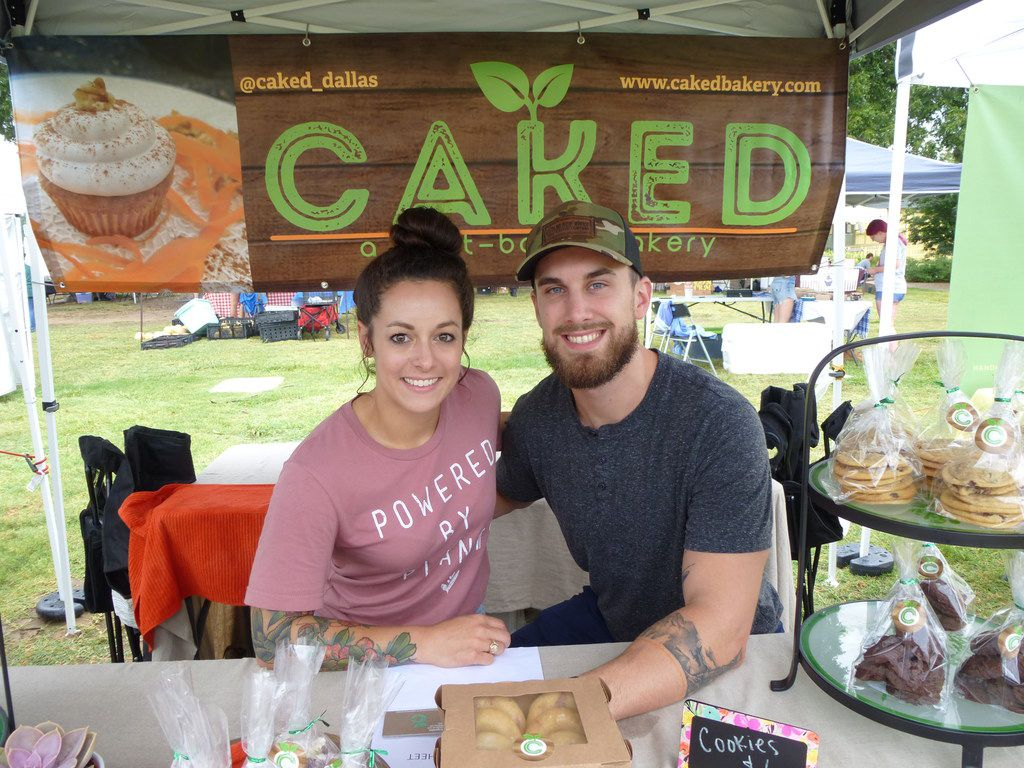 Nicole Esposito brought her Caked Bakery vegan baked goods, including strawberry donuts and lemon-poppyseed scones, to the Denton Community Market for the first time Aug. 3. Wyatt Quintero gave her a hand.