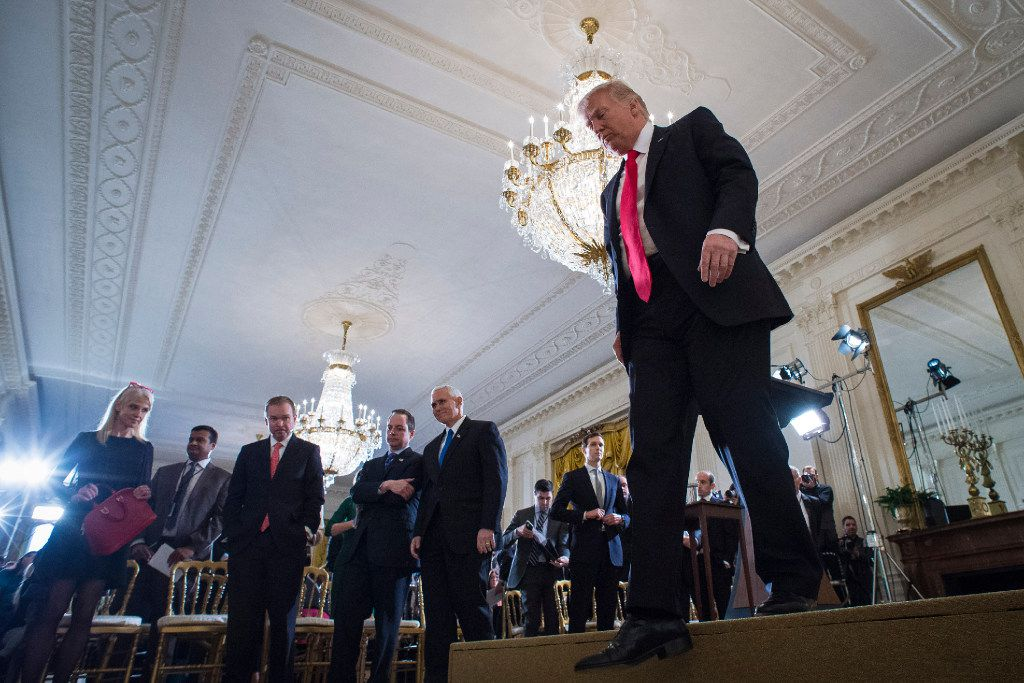 President Donald Trump walks off stage Thursday after the news conference in the East Room of the White House. (Jabin Botsford / Washington Post)