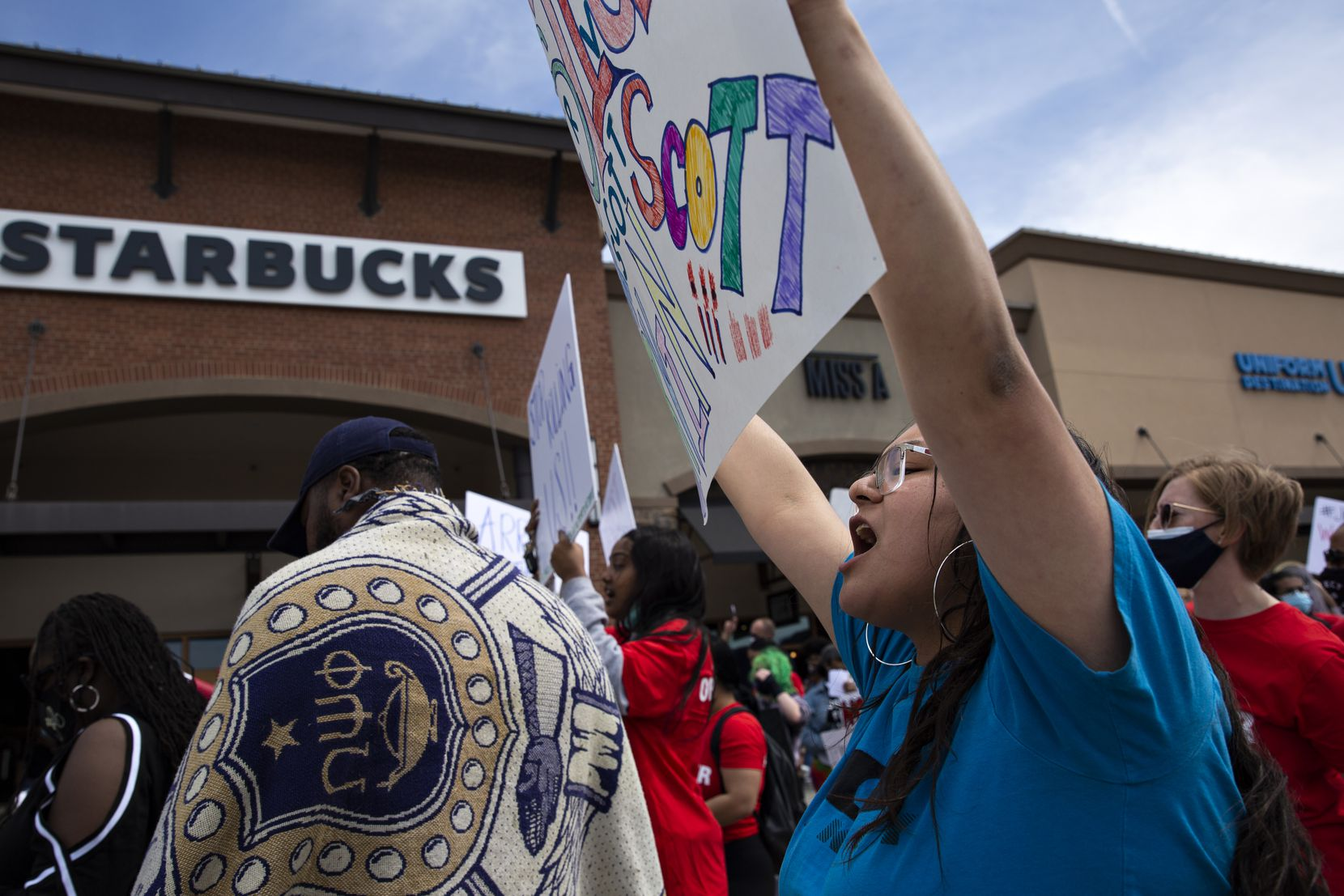 Monica Diaz yells the name of one of her best friends, Marvin Scott III, during a march to the Allen Outlets on Sunday, March 21, 2021. Those who participated in the march demanded justice for Marvin Scott III, who died a week prior while in custody at the Collin County Jail on March 14, 2021. (Shelby Tauber/Special Contributor)