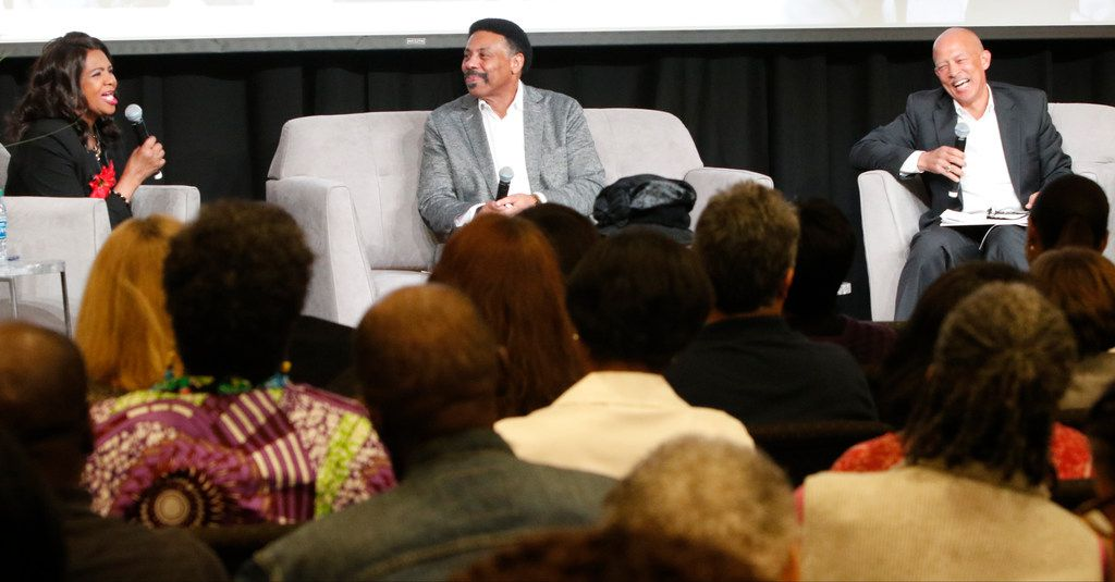 Dr. Tony Evans, center, Sr. Pastor of Oak Cliff Bible Fellowship church, and Ret. Judge John Creuzot, right, listen as Dallas County District Attorney Faith Johnson talks during an evening about life, faith and politics on Tuesday evening, Oct. 23, 2018, at OCBF church in Dallas./Staff Photographer)