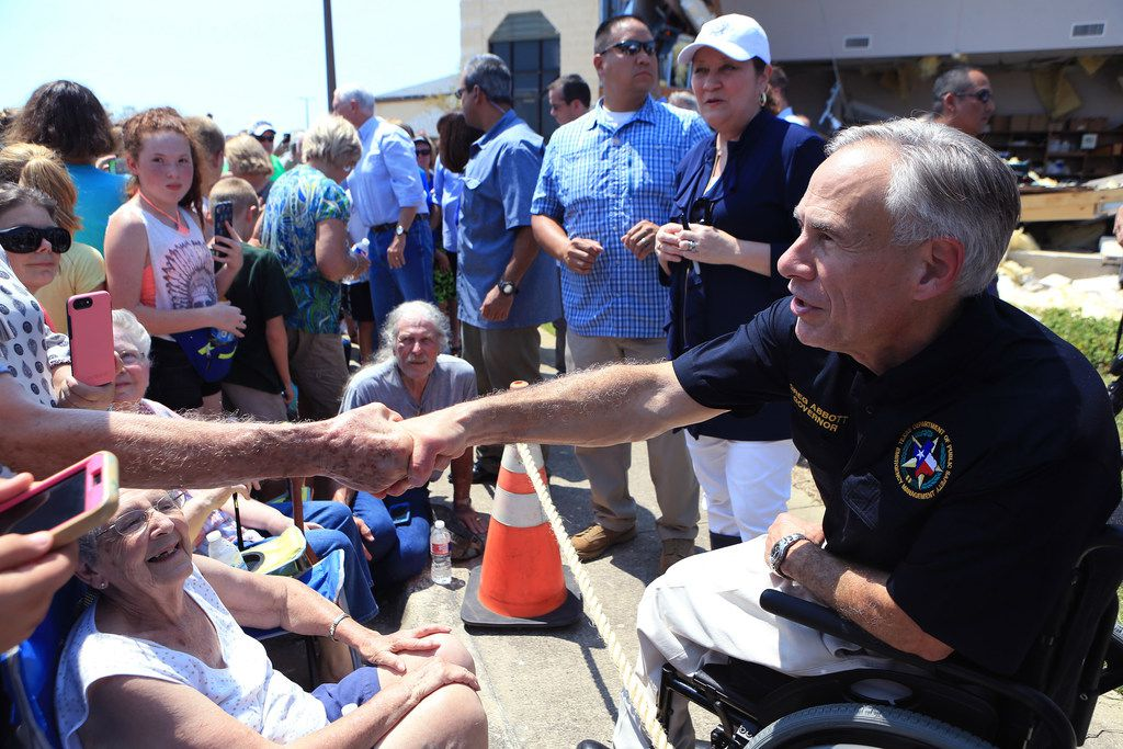 Texas Gov. Greg Abbott shakes hands with residents in Rockport after Hurricane Harvey last year. He was scheduled to be the grand marshal of a parade honoring the legacy of Martin Luther King Jr. on Monday in Arlington, but his selection drew criticism that ignited other issues related to the parade.