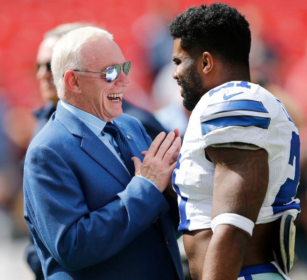 Dallas Cowboys owner and general manager Jerry Jones talks with Dallas Cowboys running back Ezekiel Elliott (21)  before a game between the Dallas Cowboys and Washington Redskins at FedEx Field in Landover, Maryland on Sunday, September 18, 2016. (Vernon Bryant/The Dallas Morning News)