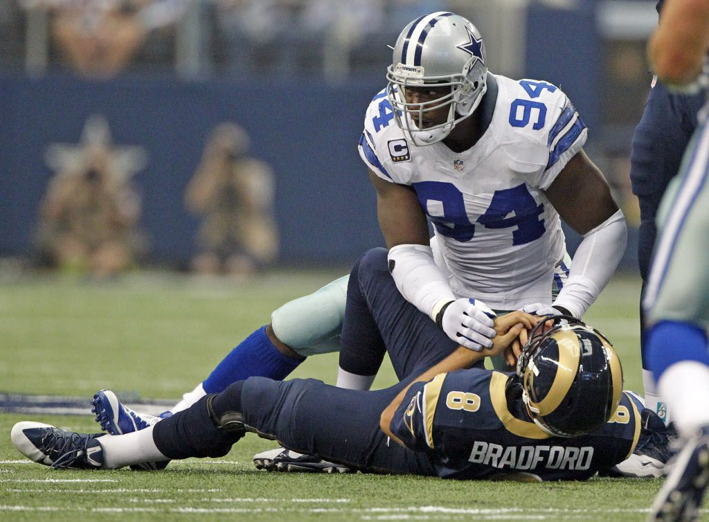 Dallas Cowboys defensive end DeMarcus Ware (94) breaks a Dallas Cowboys sack record with this sack of St. Louis Rams quarterback Sam Bradford (8) during their NFL football game in Arlington, Tx on September 22, 2013.