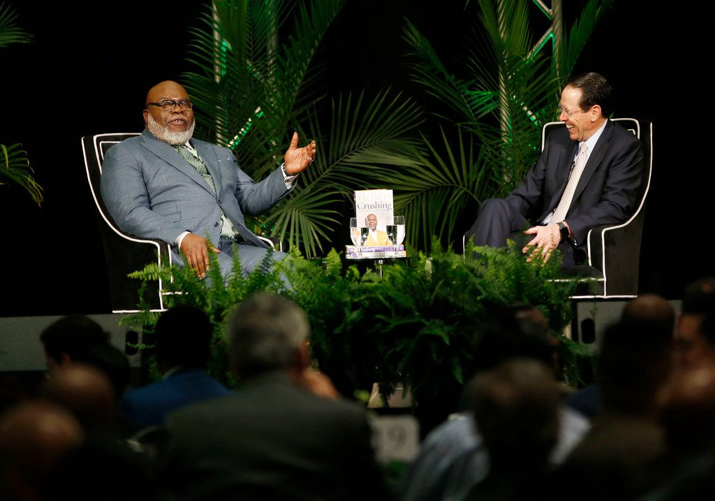 Bishop T.D. Jakes (left) and AT&T Chairman and CEO Randall Stephenson talk about how they're working together to help ex-offenders re-enter the workforce during a fireside chat at The Potter's House in Dallas on April 17, 2019. The effort is part of an AT&T initiative to fight homelessness, which is higher among people who have a criminal history and can't get back into work.