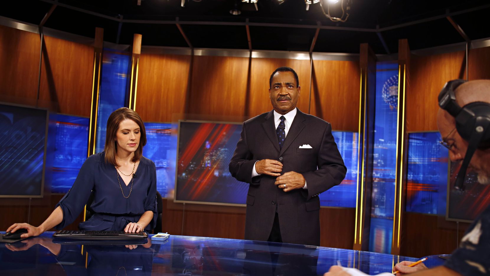 Anchors Shelly Slater and John McCaa prepares for the 5 p.m. newscast in  June 2013.