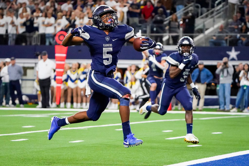 Frisco Lone Star running back Jaden Nixon celebrates as goes into to the end zone on an 18-yard touchdown run in overtime to give the Rangers a 33-27 victory over Highland Park in a Class 5A Division I Region II semifinal playoff football game at AT&T Stadium non Friday, Nov. 29, 2019, in Arlington.