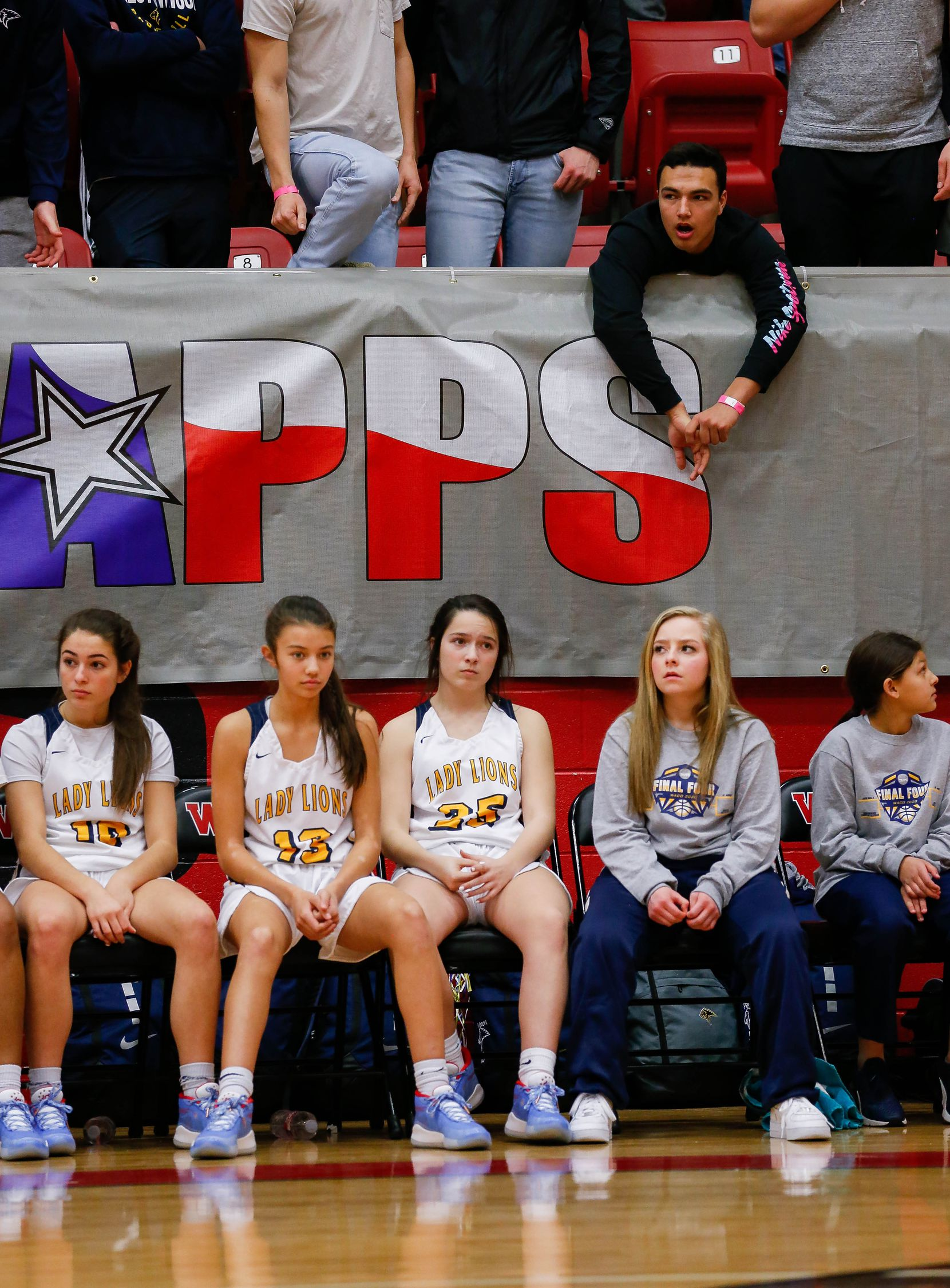 Plano Prestonwood Christian players and fans look dejected as they fall behind during the first half of a TAPPS Class 6A girls basketball state championship game against the Village School on Feb. 28, 2020 in West. Prestonwood lost 75-48.