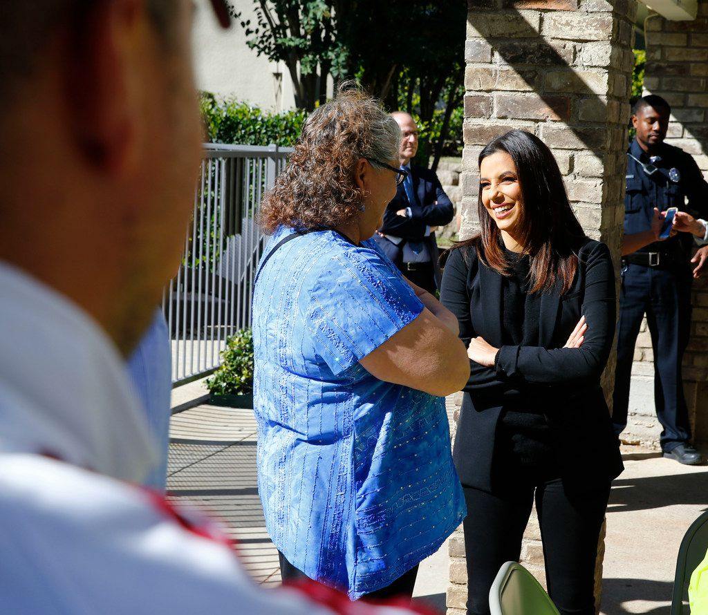 Eva Longoria (right) talks to Lucy Flores, resident of Legends at Lake Highlands.