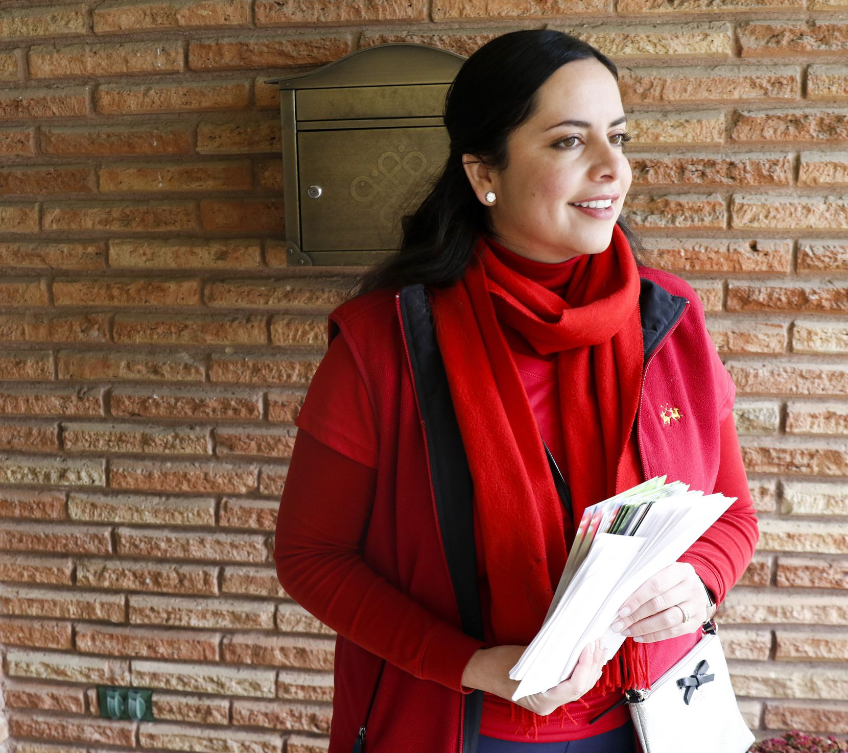 Luisa Del Rosal smiles after having a conversation with a supporter as she block walks in Texas House District 114 in Dallas, Texas on Saturday, November 23, 2019. Luisa Del Rosal is among the Republican candidates looking to take back House districts that Democrats flipped in 2018 (Benjamin M. Robinson/The Dallas Morning News)
