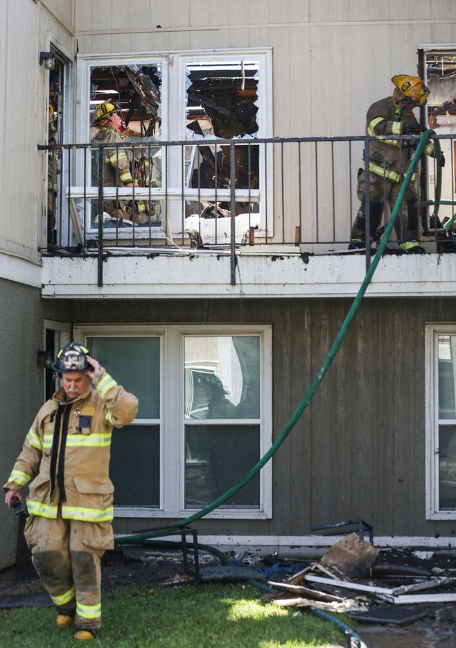 Fire crews works at the scene of a 3-alarm apartment fire at 1226 N. Masters Drive on Friday, April 26, 2019 in Dallas. (Ryan Michalesko/The Dallas Morning News)