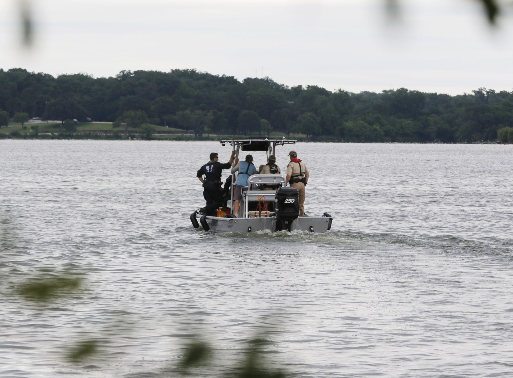 Rescuers search Monday for a man who fell off a sailboat at White Rock Lake on Sunday afternoon.