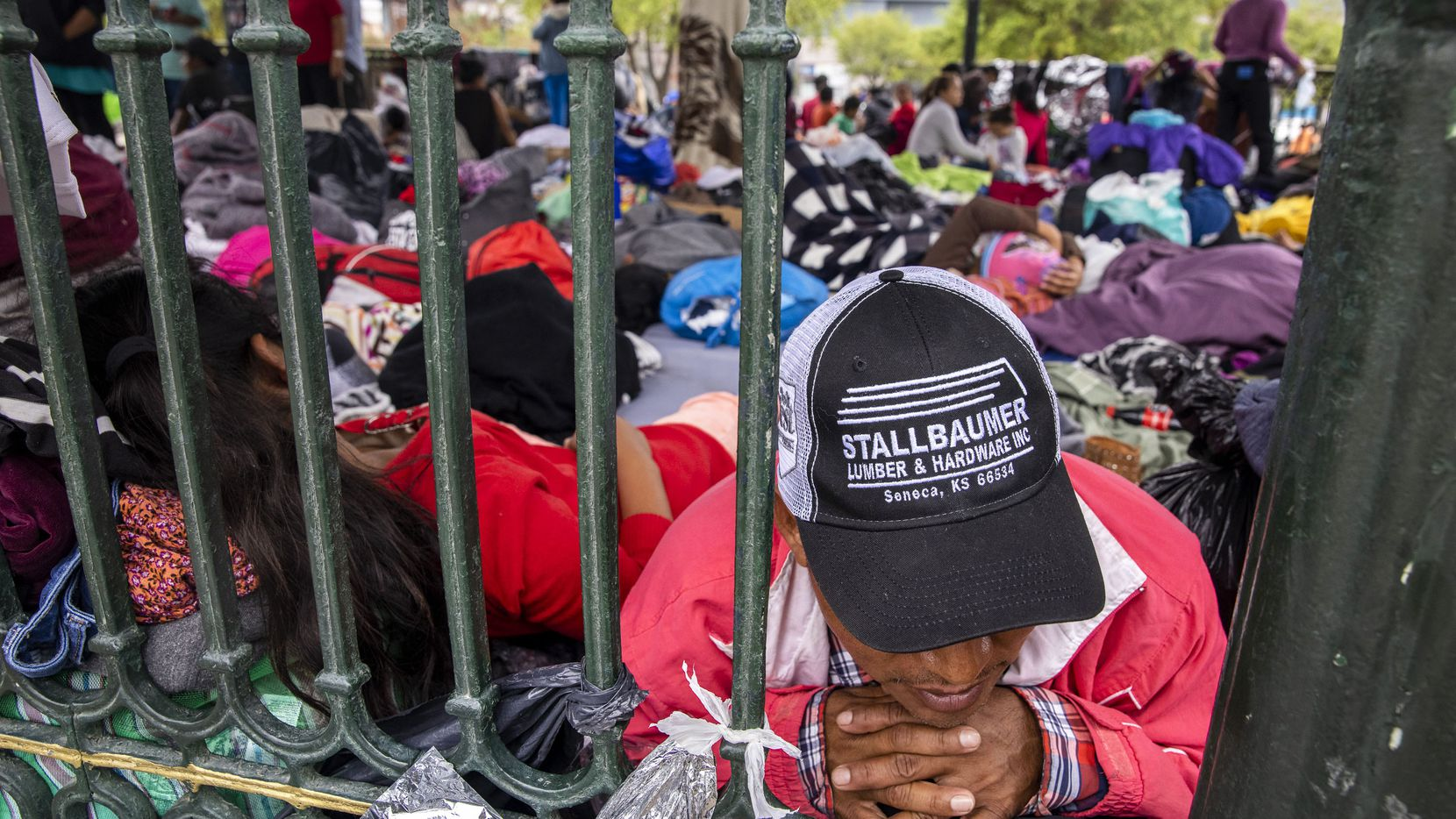 """Laureano Sanchez, a migrant from Guatemala, lays among dozens of other expelled migrants resting in a gazebo in a public square in the Mexican border city of Reynosa on Wednesday, March 31, 2021. He traveled to the U.S. with his teenage daughter only to be expelled back to Reynosa. """"It's so difficult,"""" Sanchez said of being stranded in Reynosa. """"But we know nothing is difficult for God, and there's nothing that's impossible for him."""""""