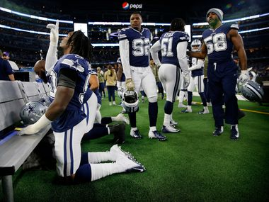 Dallas Cowboys defensive end Demarcus Lawrence (90) says a prayer on the bench before facing the Minnesota Vikings at AT&T Stadium in Arlington, Texas, Sunday, November 10, 2019. (Tom Fox/The Dallas Morning News)