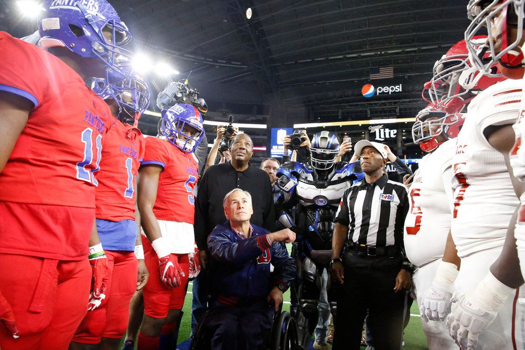 Texas State Govenor Greg Abbott flips the coin before Duncanville's game with Galena Park North Shore during the Class 6A Division I football state championship game at AT&T Stadium in Arlington, Texas on Dec 22, 2018.   (Nathan Hunsinger/The Dallas Morning News)