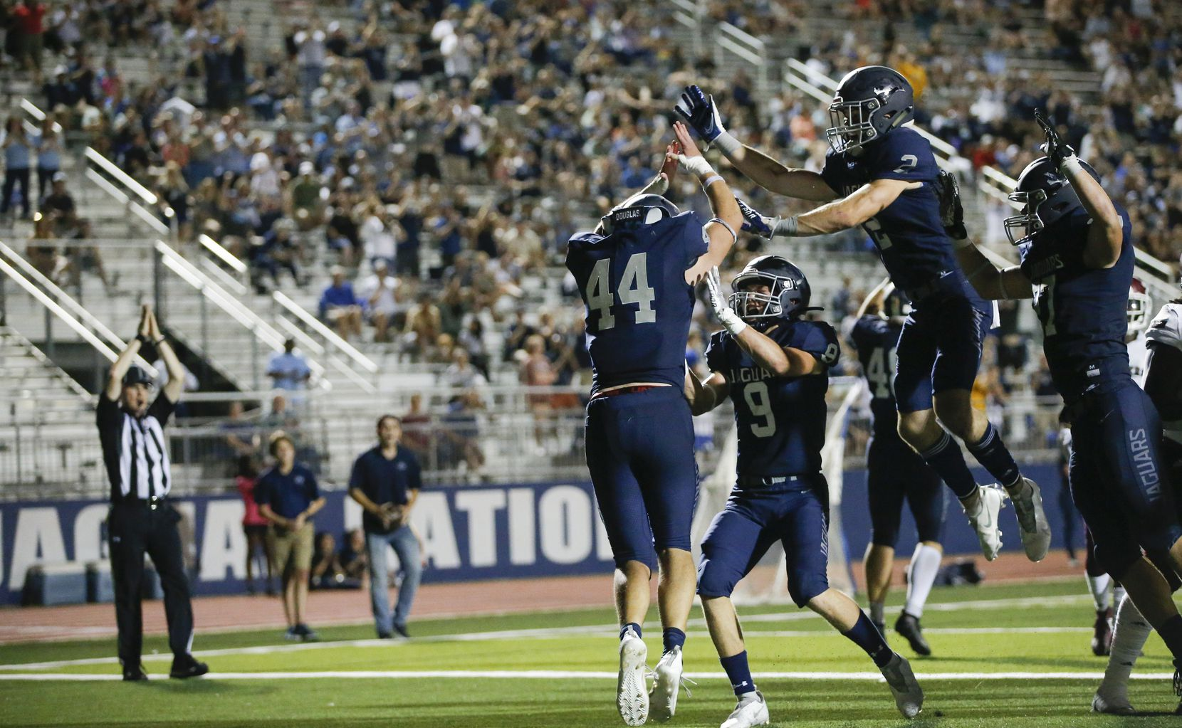 Flower Mound senior linebacker Ryan Brubaker (44) is congratulated by teammates after tackling Mesquite senior running back KD Lee in the end zone for a safety during the second half of a high school football game at Flower Mound High School, Friday, August 27, 2021. (Brandon Wade/Special Contributor)