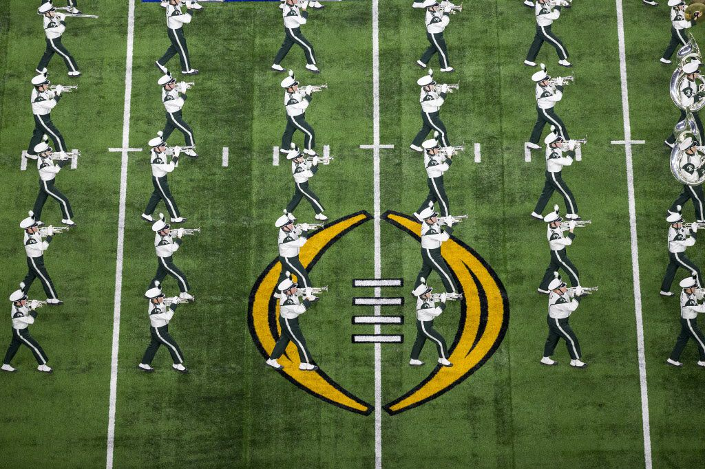 The Michigan State performs before the Goodyear Cotton Bowl game against Alabama at AT&T Stadium on Thursday, Dec. 31, 2015, in Arlington. (Smiley N. Pool/The Dallas Morning News)