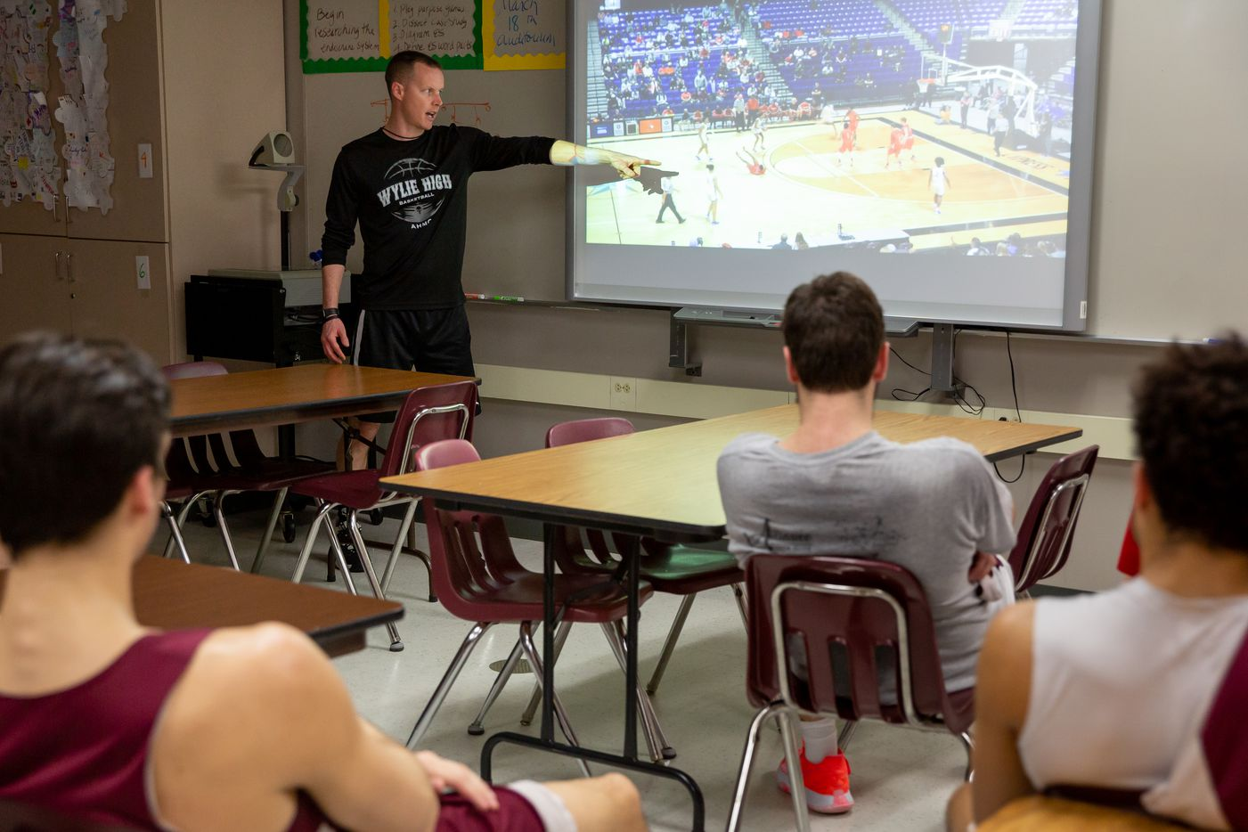 Wylie High School head basketball coach Stephen Pearce reviews clips of opposing teams and strategizes with his players at Wylie High School on March 11, 2020 in Wylie, Texas. (Kara Dry/Special Contributor)