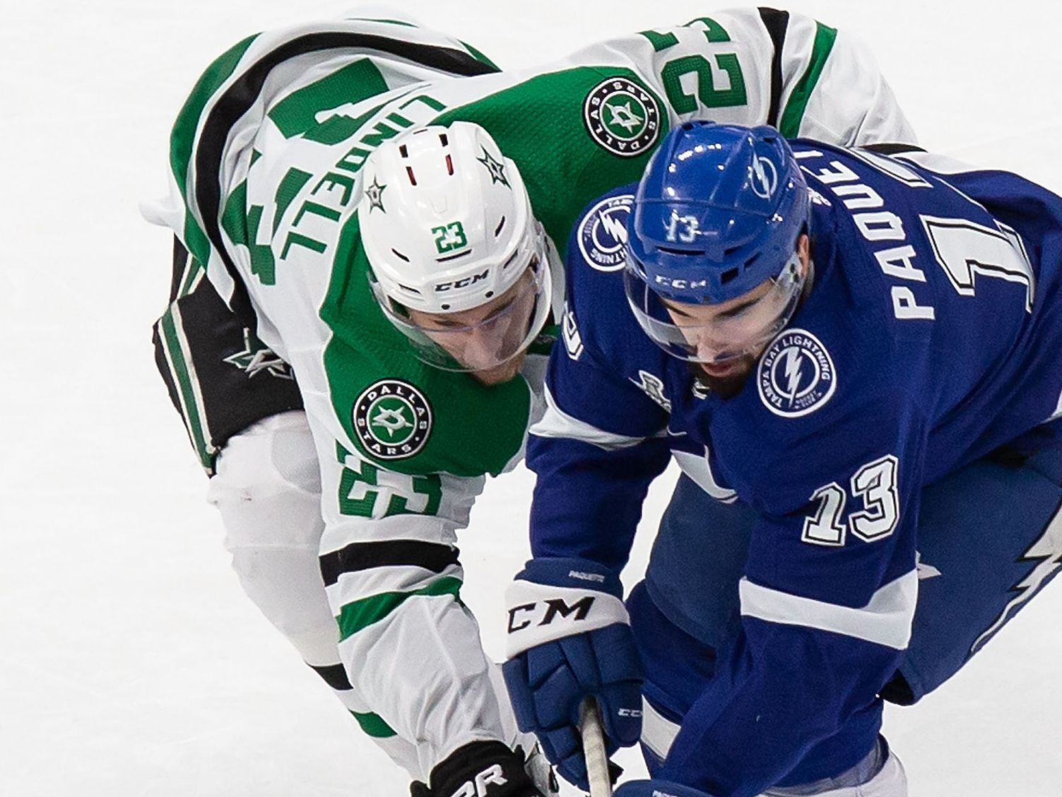 Esa Lindell (23) of the Dallas Stars battles against Cedric Paquette (13) of the Tampa Bay Lightning during Game Two of the Stanley Cup Final at Rogers Place in Edmonton, Alberta, Canada on Monday, September 21, 2020. (Codie McLachlan/Special Contributor)