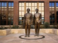 Bronze statues of former Presidents George W. Bush and George H.W. Bush are seen in the George W. Bush Presidential Center courtyard in University Park, Texas, Monday, December 2, 2019.