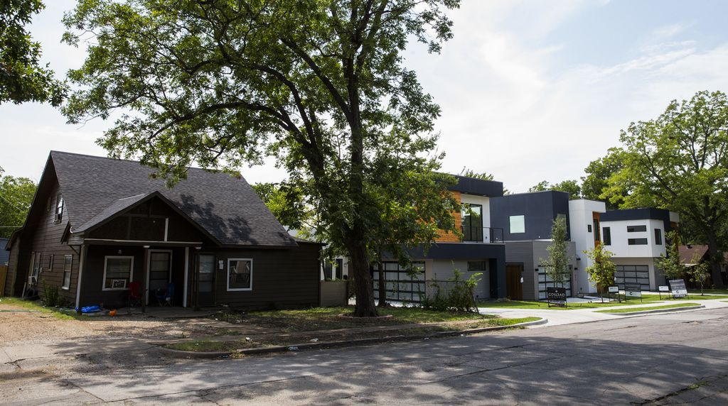 New, modern-style homes were built next door to older homes in the 500 block of Cameron Avenue.