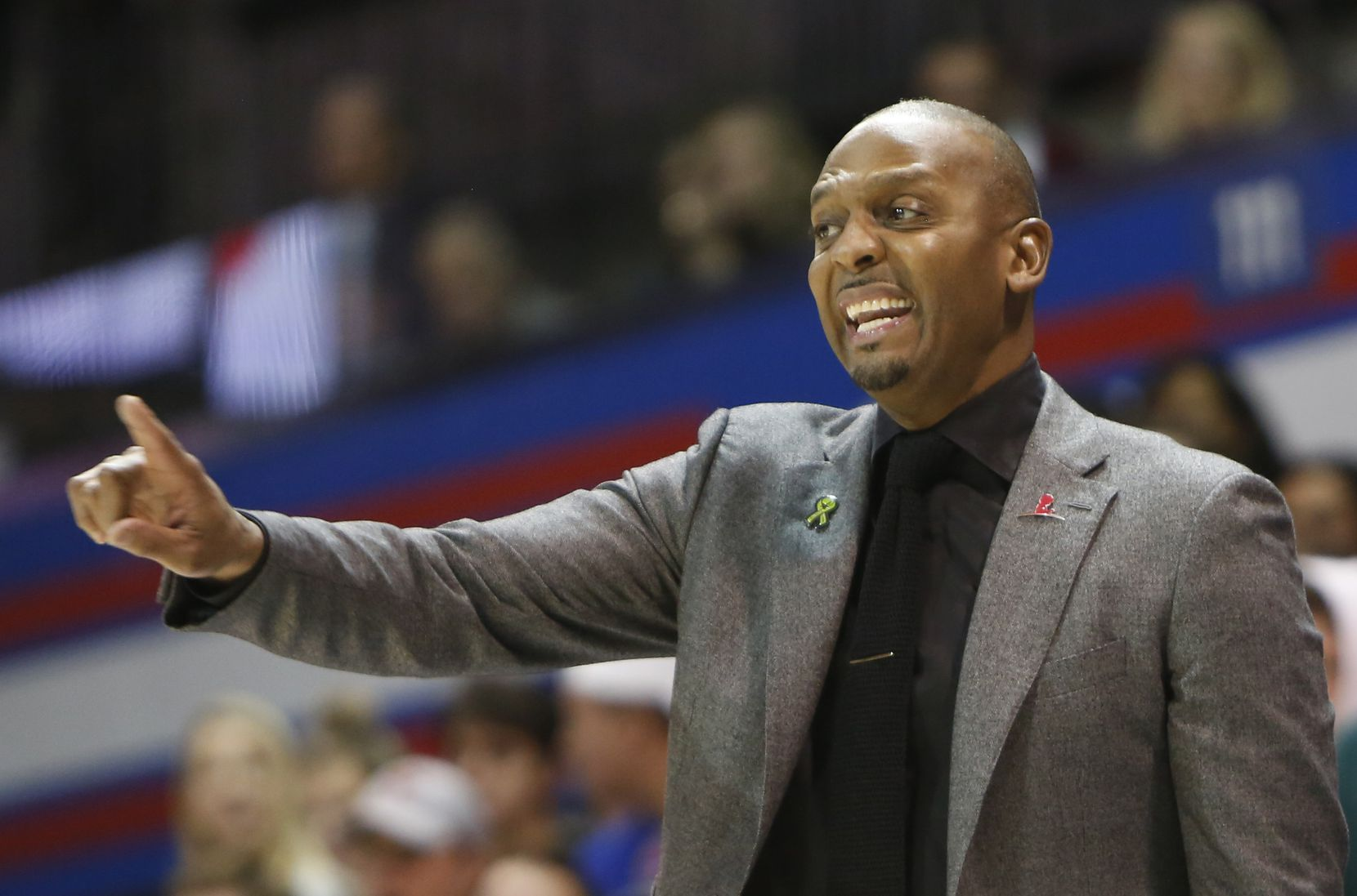 "Memphis head coach ""Penny"" Hardaway directs his players during first half action against SMU. The two teams from the NCAA's American Athletic Conference played their men's basketball game at SMU's Moody Coliseum in Dallas on February 25, 2020."