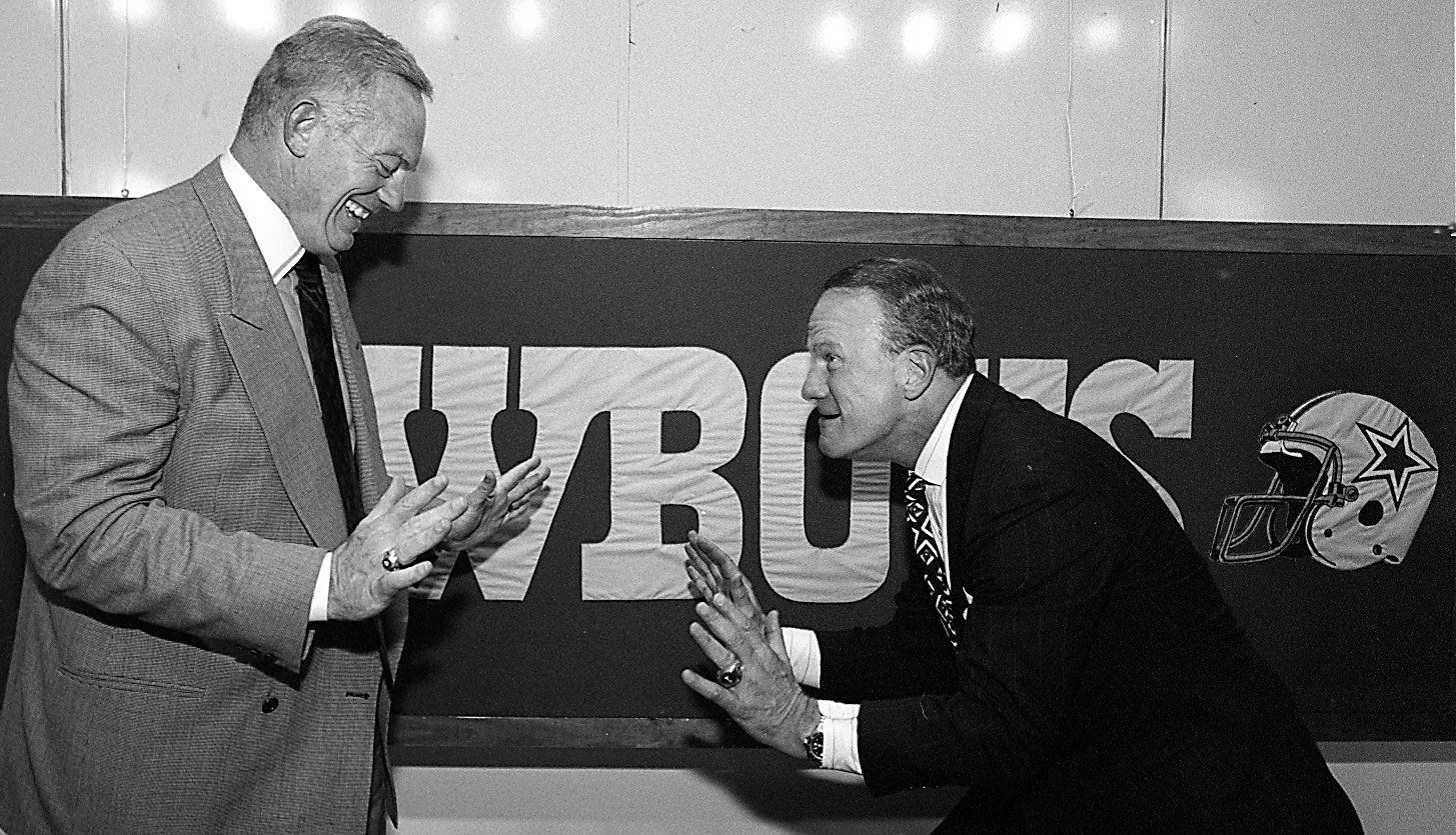 Barry Switzer (R) does a little  dance with Jerry Jones after the press conference today at Valley Ranch where he was named the new head coach of the Dallas Cowboys.