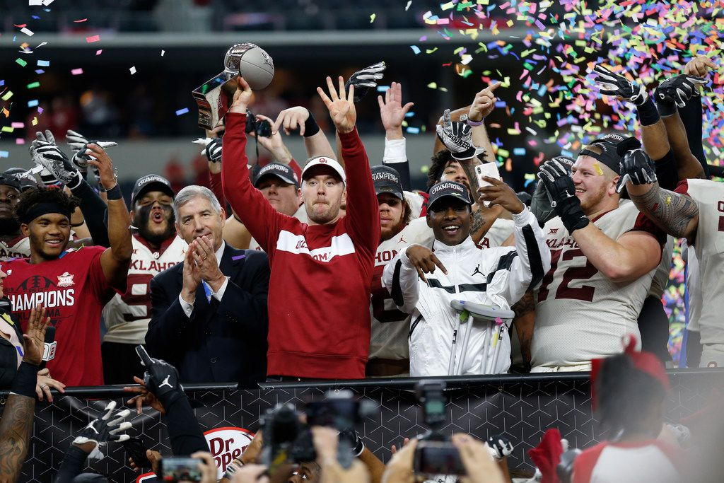 Oklahoma Sooners head coach Lincoln Riley (center) celebrates after winning the NCAA Big 12 Conference football championship against the Texas Longhorns, Saturday, Dec. 1, 2018, in Arlington, Texas. Oklahoma defeated Texas 39-27. (AP Photo/Roger Steinman)