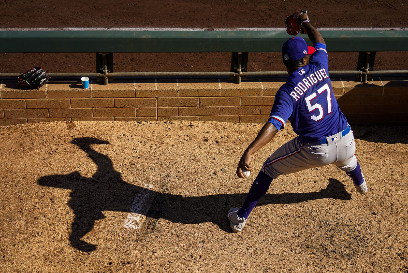 Texas Rangers pitcher Joely Rodriguez warms up in the bullpen during the sixth inning of a spring training game against the Colorado Rockies at Salt River Fields at Talking Stick on Wednesday, Feb. 26, 2020, in Scottsdale, Ariz.