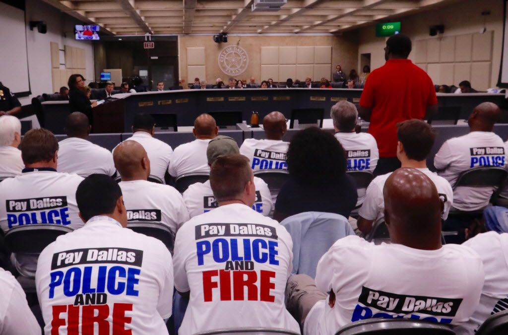 Dallas police officers, first responders and their supporters attend a meeting at Dallas City Hall asking for a raise on Wednesday, August 3, 2016. (David Woo/The Dallas Morning News)