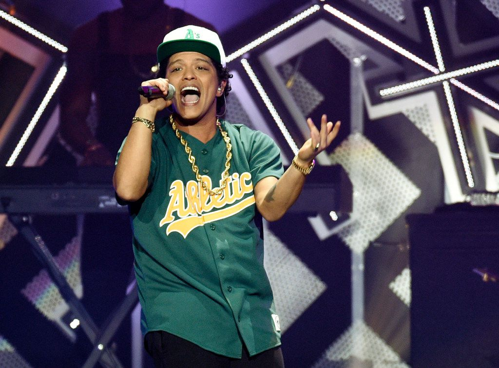Bruno Mars performs at the 2016 Jingle Ball at Staples Center on Friday, Dec. 2, 2016, in Los Angeles. (Photo by Chris Pizzello/Invision/AP)