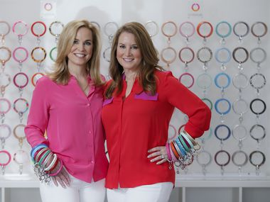 Oventure co-CEOs and founders Janie Cooke (left) and Caroline Nix pose with their Big O Key Rings.